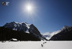 People walk over the frozen Lake Louise in the Canadian Rocky Mountains in Alberta. MARK BLINCH/REUTERS