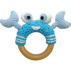 This stylish hand-crocheted crab is perfect for little hands to hold and provides a gentle and soothing rattle sound when baby shakes it.The wooden ring makes an excellent teething toy, and the cute and joyful crab with its big eyes and claws provides baby with plenty opportunities to grasp and hold.The toy conforms with the strict European child-safety standards (EN71 parts 1-3):The crochet exterior is made of a blend of 30% soft cotton and 70% bamboo fibers yarn that feels comfortable on…