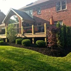 Evergreen Bushes For Landscaping around deck | Arborvitae hedge and Bloodgood Japanese Maple