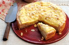 Make the most of eggs in this delicious dessert which uses fluffy egg whites in the base and rich egg yolks in the custard topping. This makes an impressive pudding to serve up to friends after dinner. Simply slice  a wedge of cake and spoon on some softly whipped cream. This cake will serve up to 12 peoople and will take 40 mins to cook in the oven.