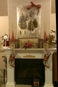 My Christmas Mantel decorations. In Colorado, they like nature, so I've incorporated natural elements in with my traditional Southern style elements...golds, reds, browns, and whites. Ignore the frame on the bottom...i forgot to move it before taking the picture! Lol. I added a vintage bell garland from World Market after this...Love it!