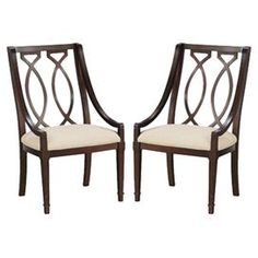 Radiata wood arm chair with marquise carved back and linen upholstered seat.  Product: ChairConstruction Material: Radiata hardwood solids, elm veneers and linenColor: Cola and ivoryFeatures:  Signature marquise shaped motifTapered legs with collar detail Dimensions: 41 H x 23 W x 24 D