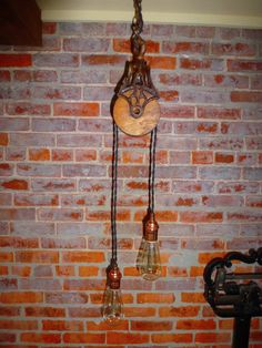 PRIMITIVE PULLY LIGHT CHANDELIER    Restored primitive cast iron and wooden barn pully has been lighted with 18G vintage style twisted cloth