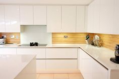 Splashbacks from LWK Kitchens - A gloss white kitchen design with Almond wood laminate splashback - Discover more at www.lwk-home.com