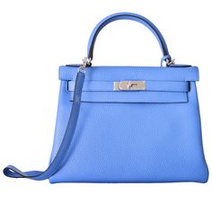 MY NEW FAVE COLOR EVER! HERMES KELLY 28cm KELLY BLUE PARADISE TOGO   From a collection of rare vintage handbags and purses at https://www.1stdibs.com/fashion/accessories/handbags-purses/