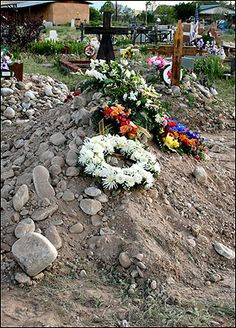 THIS humble grave is the final resting place of hellraiser DENNIS HOPPER. The Hollywood star wanted to be buried in the Native American-style burial mound — little more than a pile of rocks. Its only marker is a plastic wallet stuck in the ground with his name on. Jesus Nazareno Cemetery in Ranchos de Taos, New Mexico.