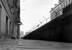 A high wall of concrete blocks, topped with barbed wire, divides Sebastian Strasse in the Kreuzberg district of Berlin, Germany, on February 15, 1962. To the left is the American sector and beyond the wall to the right is the Russian sector.