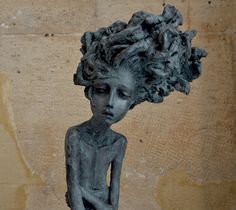 i'm in love with the emotion shown on the face of this beauty.  so mesmerizing. Sculpture by : Valerie Hadida