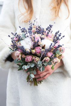 This wildflower-inspired bouquet features lavender, cotton, miniature peonies, and eucalyptus. It's super fresh and fragrant looking, while tying into the winter theme so beautifully.