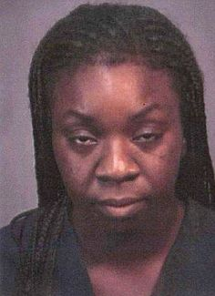 Suicide: Tanya Thomas, pictured in a police mug shot from a 2002 booking, killed her four children and herself on Tuesday morning