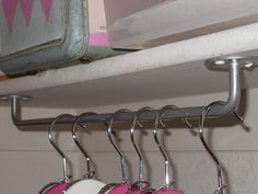 Hang towel rods upside down to use as unexpected hanging storage in the laundry room or a broom closet. Hang towel rods upside down to use as unexpected hanging storage… Home Diy, Organization, Home Organization, Laundry Room, Towel Rod, Hanging Storage, Home Improvement, Little Girl Rooms, Home Projects