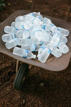 Would be really cute at wedding at oak tree!!  Red Tin Barn  water in a wheelbarrow - cute idea for a farm reception :)