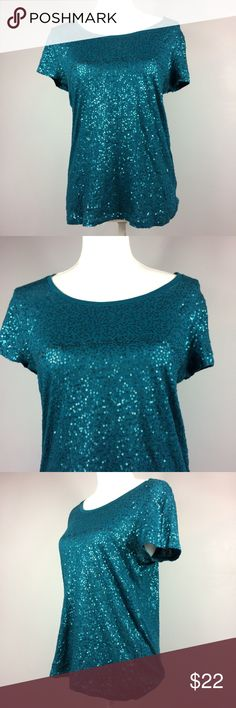 "Calvin Klein Teal Sequin Short Sleeve Top  Medium Calvin Klein Teal Sequin Short Sleeve Top Womens Size Medium 100% Cotton  Feel free to make an offer or bundle your likes and I'll send you an offer!   Measurements are laying flat 	•	Underarm to underarm 18"" 	•	Length 24"" from shoulder to hem  Condition Description: Gently used  Inventory #H28  Please check out my other items for more sizes and styles! Calvin Klein Tops Blouses"