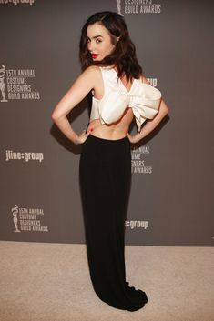 Lily Collins in Paule Ka, 2013.  Love the bow back.