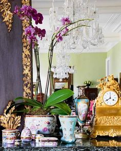 Orchids, porcelain, gilded clock-oh my.