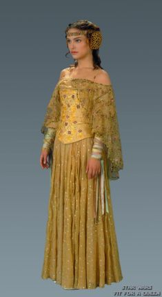 Although some the plot in Star Wars II: Attack of the Clones is iffy, you've gotta admit the costumes for it (and the whole prequel trilogy) are just incredible. This is Padme's picnic gown. From close-up, you can really appreciate the intricate embroidery.