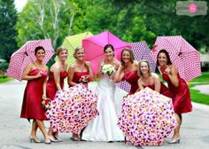 Mix and match umbrellas and red dressed for the bridesmaids!