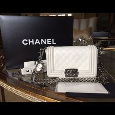 Authentic White Novelty leather CHANEL Flag bag, like new, adjustable leather strap, silver designer chain strap, cloth case, original box.    No trades CHANEL Bags