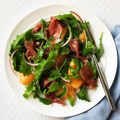 Reinvent a familiar appetizer as a bright salad bursting with sweet and salty flavor from cantaloupe, prosciutto, arugula and a red wine vinaigrette.