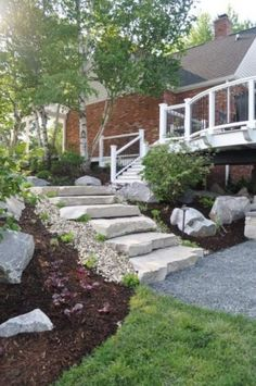 stone steps + mulched hill + landscaping