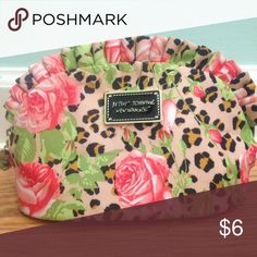 Betsey Johnson Makeup Bag Small makeup sized zip bag, cheetah and rose print pattern over pale pink. Never been used! Betsey Johnson Bags Cosmetic Bags & Cases