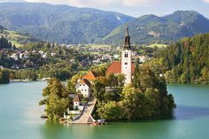 Lake bled, slovenia Bled Castle, Lake Bled, Slovenia  Perched atop a steep cliff more than 100m above the lake, Bled Castle is how most people imagine a medieval fortress to be. The town features a little white church on an island in the center of an emerald green mountain lake.