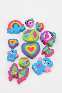 Lisa Frank Erasers! I just would let those badboys rot in the bottom of my pencil case, cause I didn't want to use them! XD They were too cool to use...