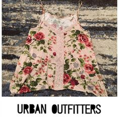 UO Staring at Stars Floral Tank Top UO Staring at Stars Floral Tank Top. Straps are not adjustable. Length is 27 inches. Bust is 18 inches. Flowy top. Spaghetti straps. Lace accent down the front. Feel free to make an offer. No trades. Urban Outfitters Tops Tank Tops
