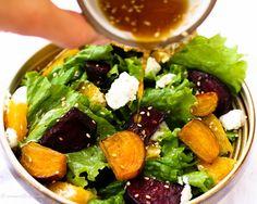 Roasted Beet Salad with Orange Citrus Vinaigrette and Goat Recipe Salads with golden beets, red beets, orange, olive oil, sea salt, cane sugar, goat cheese, lettuce, rice vinegar, orange juice, olive oil, chopped fresh mint, dijon mustard, minced garlic, honey