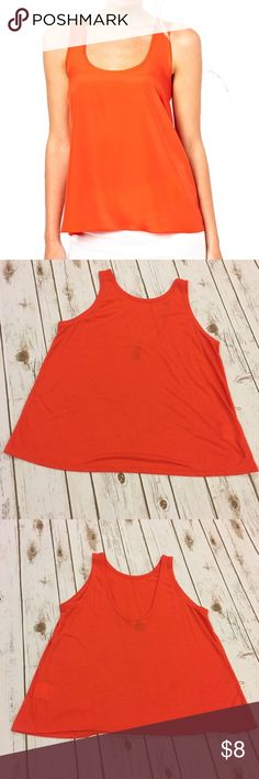 "NWOT Orange Old Navy Tank Top NWOT never worn orange Old Navy Tank Top. Measures from pit to pit 19""/ length 23.5"". Made of polyester/ rayon/ linen blend. PRICE FIRM. NO TRADES. Pic 1 for modeling purposes only. Old Navy Tops Tank Tops"