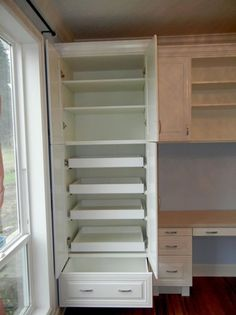 neat way to organize inside of a storage cabinet...pullouts and shelves