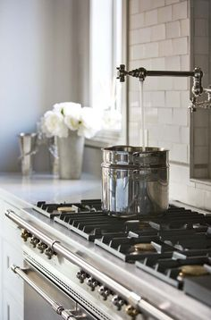 Stainless steel French Lacanche range with custom designed zinc and steel range hood (Cultivate.com)