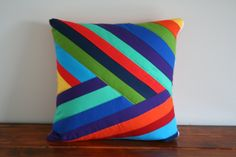 Bold rainbow design made for a 16x16 in pillow form. Front measures 16 x 16 inches. Back of the pillow is orange with white polka dots. Bottom of p...
