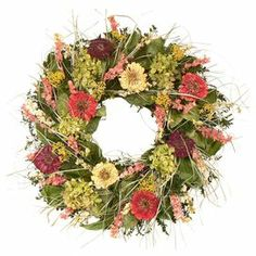 """Mixed preserved floral wreath with a natural twig base.   Product: Preserved floral wreathConstruction Material: Natural twig base and preserved materialsColor: Green, pink and purpleDimensions: 20"""" Diameter x 4"""" DCleaning and Care: Avoid direct sunlight and humidity. Wipe gently clean with dry cloth."""