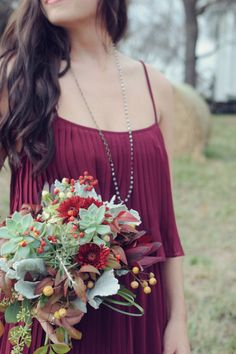 Burgundy bridesmaid with natural garden bouquet. #bridesmaids #bouquet #weddingchicks Dress: Forever 21 ---> http://www.weddingchicks.com/2014/04/29/family-farmhouse-wedding-retreat/