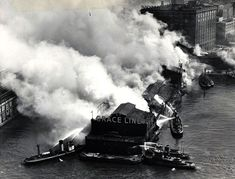 Fire Boats fight a blaze at Grace Line Pier 57, West 15th St, near the National Biscuit Co. building. (Courtesy NYC Municipal Archives)