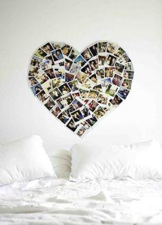 Polaroids in hartvorm boven het bed. Wow wat leuk bedacht zeg om je polaroids zo op te hangen. Geeft een hele mooie romantische sfeer aan de slaapkamer