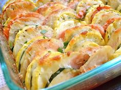 zucchini, tomato, potato, summer squash, onion, garlic, olive oil, shredded cheese.  30 min. covered, 10 - 15 uncovered with cheese.  350