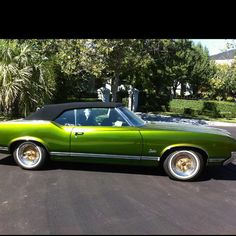 E40's car .... well one like it ... he says its booger green 1970 cutlass with darth vader black convertible top