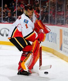 NEWARK, NJ - JANUARY 19: Jonas Hiller #1 of the Calgary Flames clears the puck in the second period against the New Jersey Devils on January 19,2016 at Prudential Center in Newark, New Jersey. (Photo by Elsa/Getty Images)