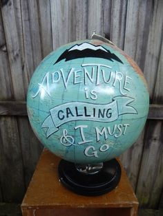 This 12 vintage globe is dutch and I estimate it to be from the 70s. It has a rich medium blue-green background and classy brown wood disk base.