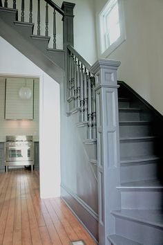 KAEMINGK DESIGN:  Modern Victorian farmhouse staircase painted charcoal.
