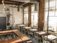 Interior of Oxheart via @gindesigns with reclaimed wood tables made in collaboration with Dumptruck design and handmade copper lighting by Gin Braverman.