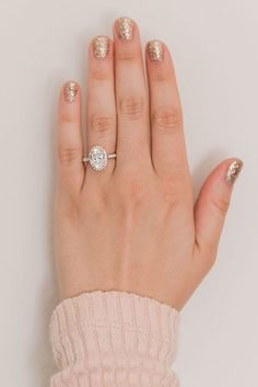 The prettiest oval engagement ring and gold glitter mani