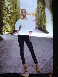 White blouse, black jeans