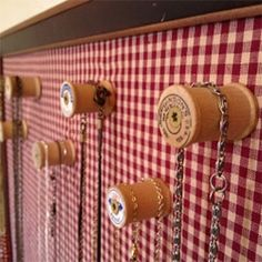 The spools are a good alternative to hooks because there is a lot less stress on the components--especially clasps.  Vintage Spool Necklace Display