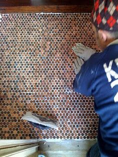Penny tiled floor.  Awesome idea!  Kitchen backsplash or maybe in the bathroom??