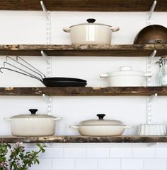 love this open shelving // white brackets that blend into the wall, and distressed wood shelves