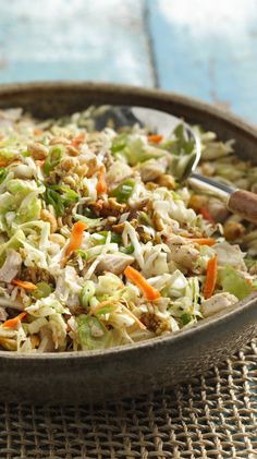 Crunchy Chicken Salad INGREDIENTS 3 tablespoons butter or margarine 1 package (3 ounces) Oriental-flavor ramen noodle soup mix 2 tablespoons sesame seed 1/4 cup sugar 1/4 cup white vinegar 1 tablespoon vegetable oil 1/2 teaspoon pepper 2 cups cut-up cooked chicken 1/2 cup dry-roasted peanuts 4 medium green onions, sliced (1/4 cup) 1 bag (16 ounces) coleslaw mix