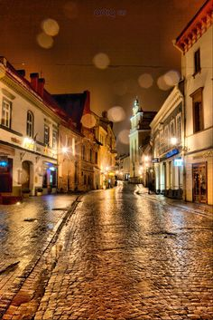 I love this place. Looks so nostalgic with the rain! Pilies Gatve, Vilnius, Lithuania